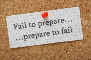A reminder that if you fail to prepare you are preparing to fail typed on a piece of graph paper pinned to a cork notice board. Advice on the difference between failure and success.
